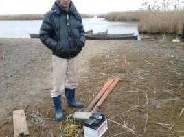 pescuiau cu undita electrica pe lacul Manta